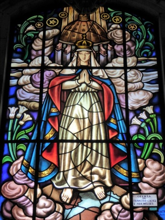 Stained glass window depicting the Virgin Mary. Photo by T.