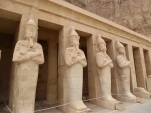 Restored statues of Osiris on the upper terrace. Photo by Tricia.